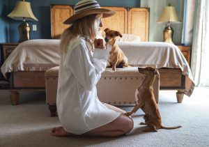 woman, girl, dog, bedroom, house, home, holding her dog,